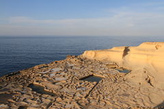 Salt pans. Salt evaporation ponds (salt pans) located near Qbajjar on the maltese Island of Gozo royalty free stock photo