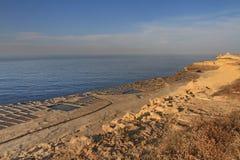Salt pans. Salt evaporation ponds (salt pans) located near Qbajjar on the maltese Island of Gozo stock photography