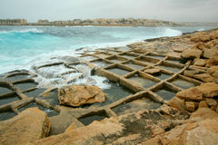 Sea filling salt pans. Salt pans filling with sea water at Marsaskala on the east coast of Malta Royalty Free Stock Images