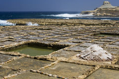 Salt Pans - Gozo - Malta. Salt pans on the coast at Qbaijar near Marsalforn on the small island of Gozo in the Mediterranean islands of Malta. Local people use Royalty Free Stock Images
