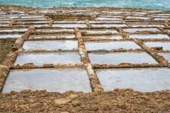 Salt Pans Gozo. Salinas. Salt Pans or salters in Marsalforn Malta Gozo. rough sea filling them up stock image