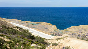 Salt pans Gozo. These 350-year-old salt pans, stretch about 3km along the coast Stock Photos
