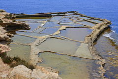 Salt pans and sea stock images