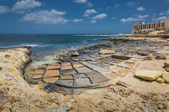 Salt pans in Marsaskala, Malta. Salt pans in Marsaskala on the island Malta, Mediterranean sea Stock Photos