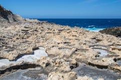 Salt Pans near Azure Window at Gozo island, Malta. Royalty Free Stock Images