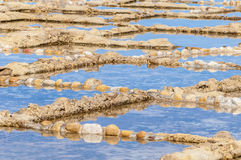 Salt pans near Qbajjar in Gozo, Malta. Salt evaporation ponds, also called salterns or salt pans located near Qbajjar on the maltese Island of Gozo Royalty Free Stock Photo
