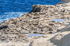 Salt pans near Qbajjar in Gozo, Malta. Royalty Free Stock Photography