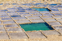 Salt pans near Qbajjar in Gozo, Malta. Stock Photos