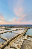 Salt pans near Qbajjar in Gozo, Malta. Royalty Free Stock Images