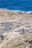 Salt pans near Qbajjar in Gozo, Malta. Stock Image