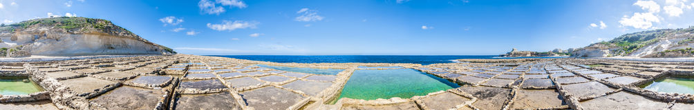 Salt pans near Qbajjar in Gozo, Malta. Salt evaporation ponds, also called salterns or salt pans located near Qbajjar on the maltese Island of Gozo Stock Image