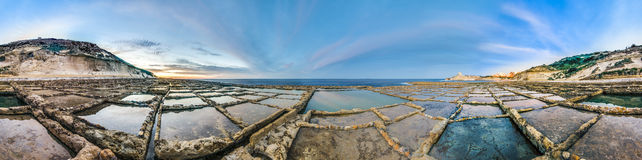 Salt pans near Qbajjar in Gozo, Malta. Salt evaporation ponds, also called salterns or salt pans located near Qbajjar on the maltese Island of Gozo Royalty Free Stock Image