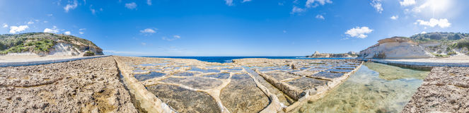 Salt pans near Qbajjar in Gozo, Malta. Salt evaporation ponds, also called salterns or salt pans located near Qbajjar on the maltese Island of Gozo Stock Photo
