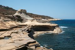 Malta and Gozo islands as tourist destinations. Salt pans and rocks at Gozo islands, Malta Stock Image