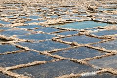 Malta and Gozo islands. Salt pans at the sea near to Marsalforn, Gozo island, Malta - close up Stock Photo