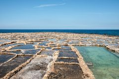 Malta and Gozo islands. Salt pans at the sea near to Marsalforn, Gozo island, Malta Royalty Free Stock Photography