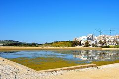 Salt pans and town buildings, Buggiba. Stock Photo