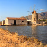 Salt pans, Trapani. View of windmill in the salt pans, Trapani. Sicily stock photo