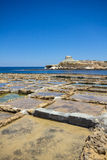 Salt pans. Salt pans used for harvesting sea salt. Xwejni Bay, Gozo island, Malta Royalty Free Stock Images