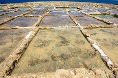Salt pans. Salt pans used for harvesting sea salt. Xwejni Bay, Gozo island, Malta Royalty Free Stock Photos