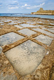 Salt pans on Xwejni Bay, Zebbug, Gozo, Malta. Touristic attraction for traveler Royalty Free Stock Images