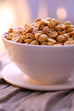Salt peanuts in bowl Stock Images