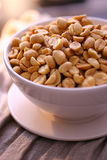 Salt peanuts in bowl Royalty Free Stock Photo
