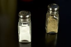 Salt and Pepper 2. Photo of salt and pepper shakers on black stock photo