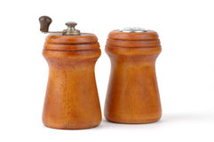 Salt and Pepper. Salt shaker and pepper mill on a white background Royalty Free Stock Image