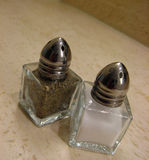 Salt and pepper. Miniatures. Food ingredients Stock Photo