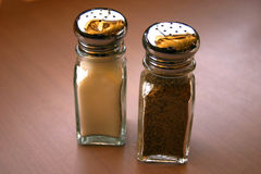 Salt and pepper. On a table Stock Images