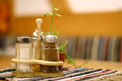 Salt and Pepper. A salt and pepper shaker on a table with selective focus Royalty Free Stock Images