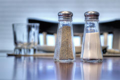 Salt and Pepper. Shakers at the dinner table Stock Image