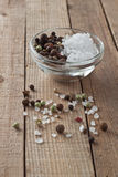 Salt and pepper. Bowl with sea salt and peppercorns Stock Photos