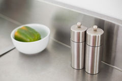 Salt and pepper on a chrome counter Royalty Free Stock Images