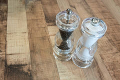 Salt and Pepper in clear plastic shaker Stock Photography