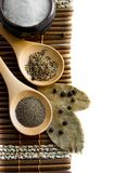 Salt, pepper, cumin and bay leaf Royalty Free Stock Image