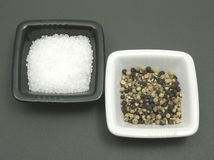Salt and pepper on a dull matting Stock Images