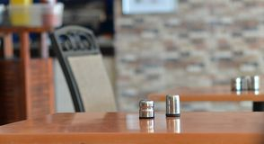 Salt and pepper. On an empty table Royalty Free Stock Photography
