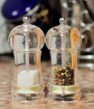 Salt and pepper. Glass salt and pepper shakers stock photography