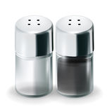 Salt and pepper glass shakers isolated Royalty Free Stock Photography