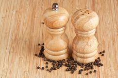 Salt and pepper grinders on a table Stock Photos