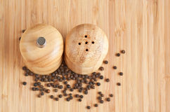 Salt and pepper grinders on a table Royalty Free Stock Photography
