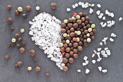 Salt and pepper heart. Heart of sea salt and peppercorns Royalty Free Stock Photos
