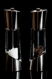 Salt and pepper mills. Fancy salt and pepper mills on a black background Stock Photography