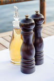 Salt and pepper mills on restoran table.  Royalty Free Stock Image