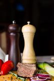 Salt and Pepper Mills with Sliced Beef Royalty Free Stock Image