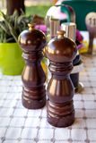 Salt and pepper mills. On the table Stock Photo