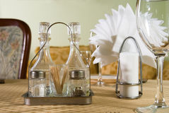 Salt, pepper napkin and a glass. Salt,pepper napkin and a glass are on the table Stock Images