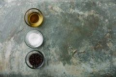 Salt, pepper and oil Stock Photos